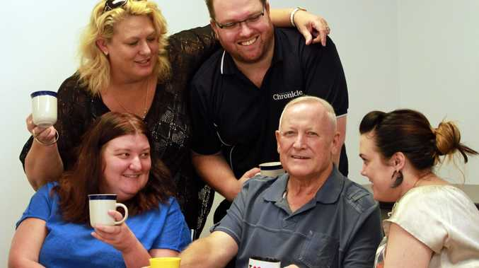Fraser Coast Chronicle journalist Alan Betteridge surrounded by supportive workmates.