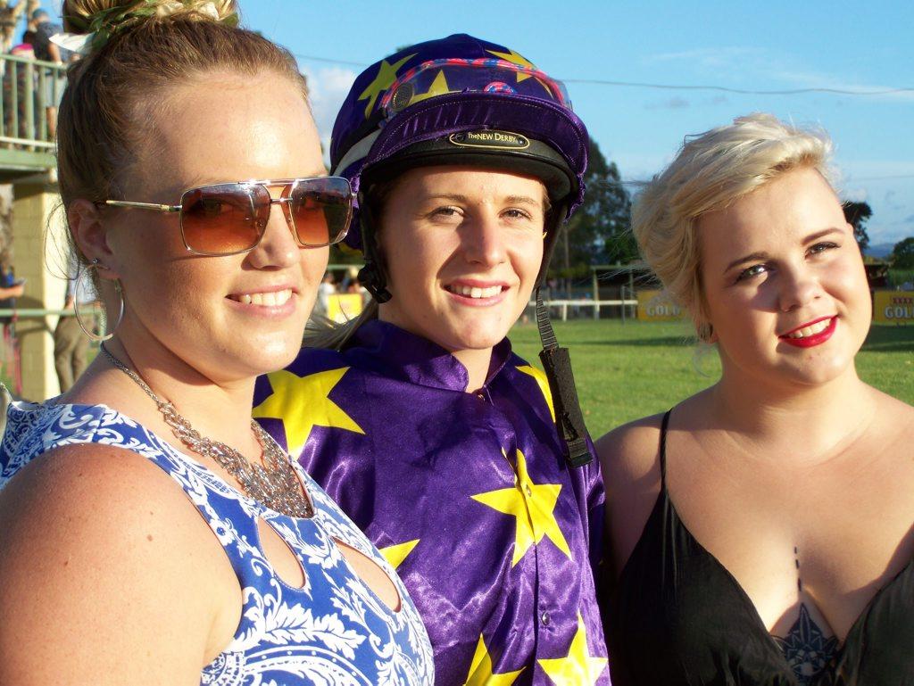 Apprentice jockey Bella Rabjones (centre) with friends Samantha and Gracie.