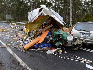 Highway blocked after caravan and truck collide