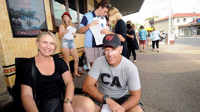 HAPPY TIMES: Sandy and Garry Meredith of Ballina got in early for Splender in the Grass tickets when the tickets went on sale at the Great Northern in Byron Bay on Sunday.
