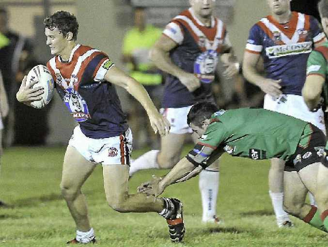 Thomas Caterson busts through the Tannum Sands defence during his side's 26-10 win.