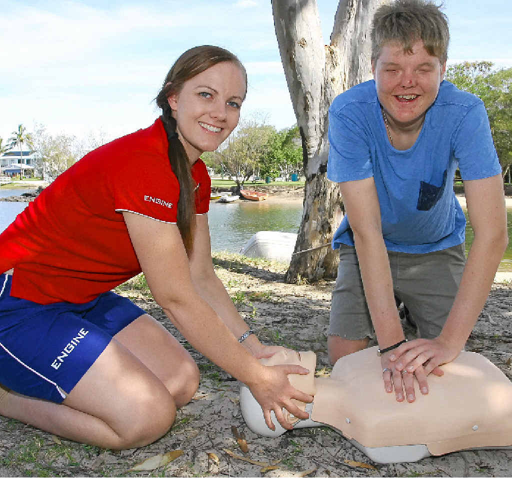 GETTING THE FEEL OF IT: Mooloolaba Surf Lifesaving Club's Michelle Jacobson will teach CPR to blind radio operator Blake Ison.