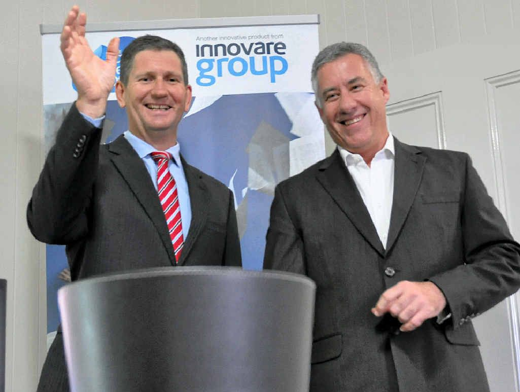 WELCOME: Local member Lawrence Springborg with CEO of Innovare Group Phil Charge.