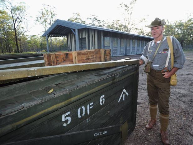 Toogoom and District RSL Sub Branch president Ken Higgins in front of a Lysaght hut from the Vietnam war that the army has erected for Vietnam Veterans at Toogoom.