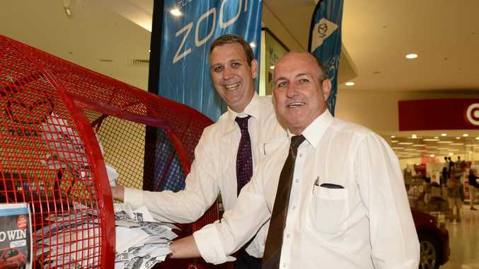 Daily Examiner general manager Nigel Irving and Shopping World Centre manager Gerg Hayes at the Daily Examiner lucky draw on Saturday. Photo Debrah Novak / The Daily Examiner