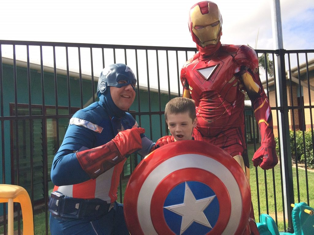 Hervey Bay RSL's Captain America and Iron Man with Memphis Norrie at the official opening of Hervey Bay Hospital's revamped pediatrics ward.