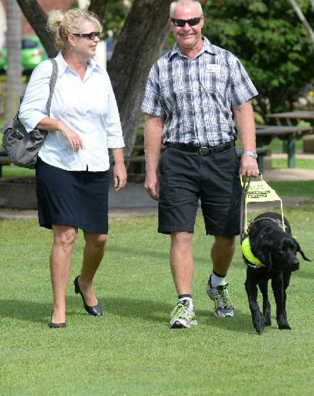 AWARENESS WEEK: Guide Dogs Queensland's Nerida Hepple and vision-impaired man Graeme Raines with his guide dog, Levi.