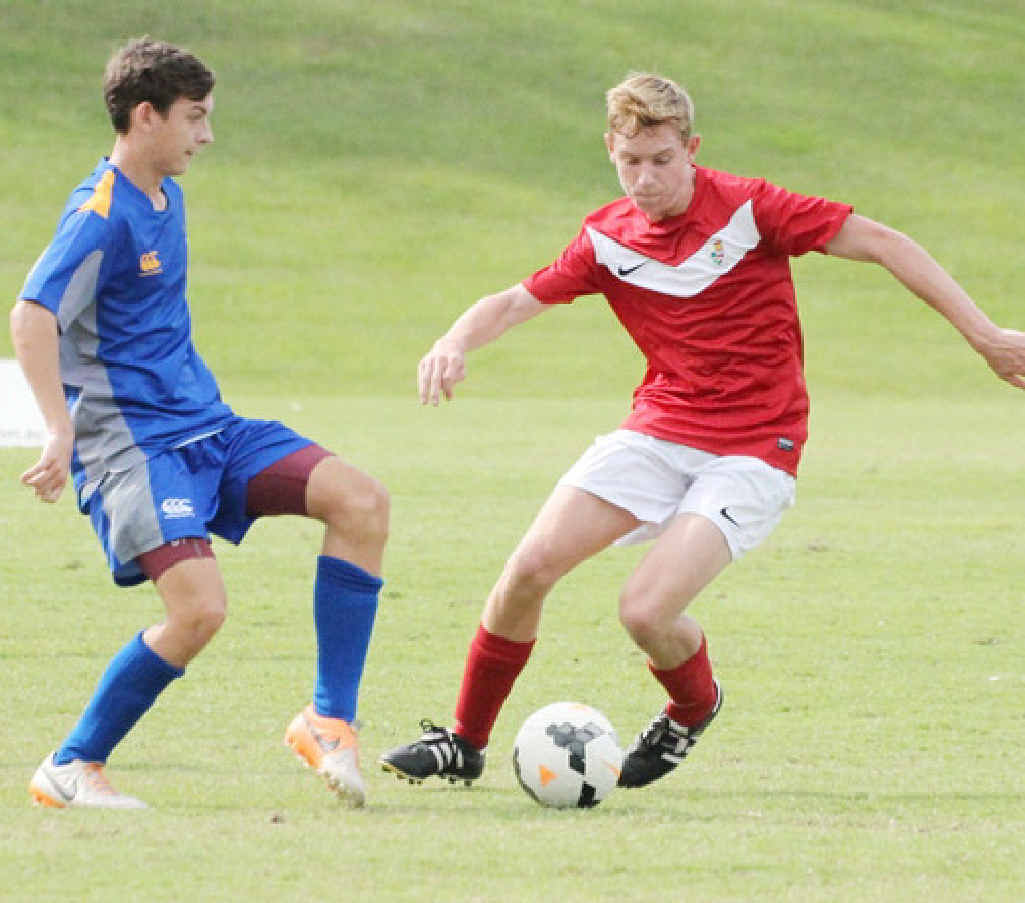 IGS 1st XI player Tommy Jarrard (right) in action in his team's opening round loss.