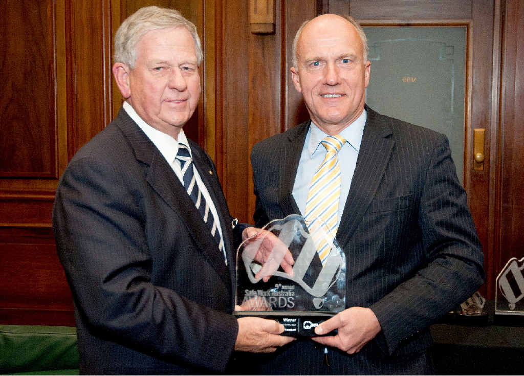 HIGH HONOUR: Ross Fraser from Frasers Livestock Transport accepts the Safe Work Australia award from Senator Eric Abetz at a ceremony in Canberra Monday night.