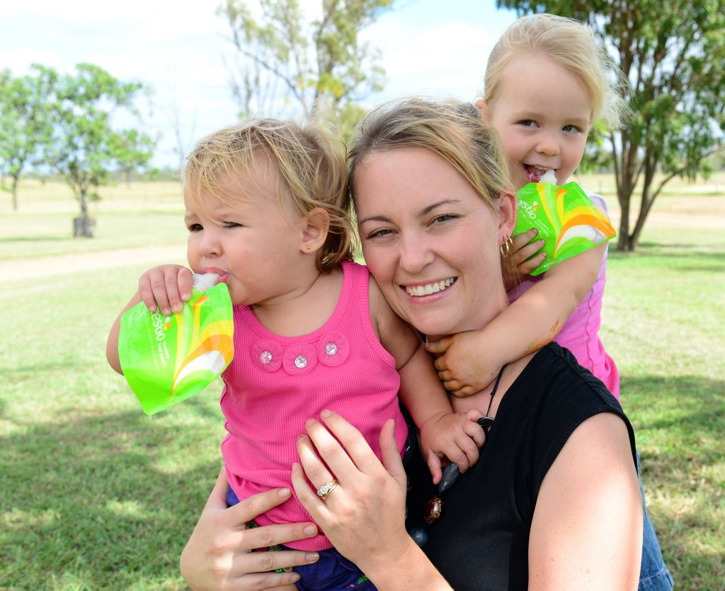 Krystal Caton and her children Aria, 13 months and Sienna, age 3, with Krystal's product Zestio, a reusable food pouch. Photo Sharyn O'Neill / The Morning Bulletin