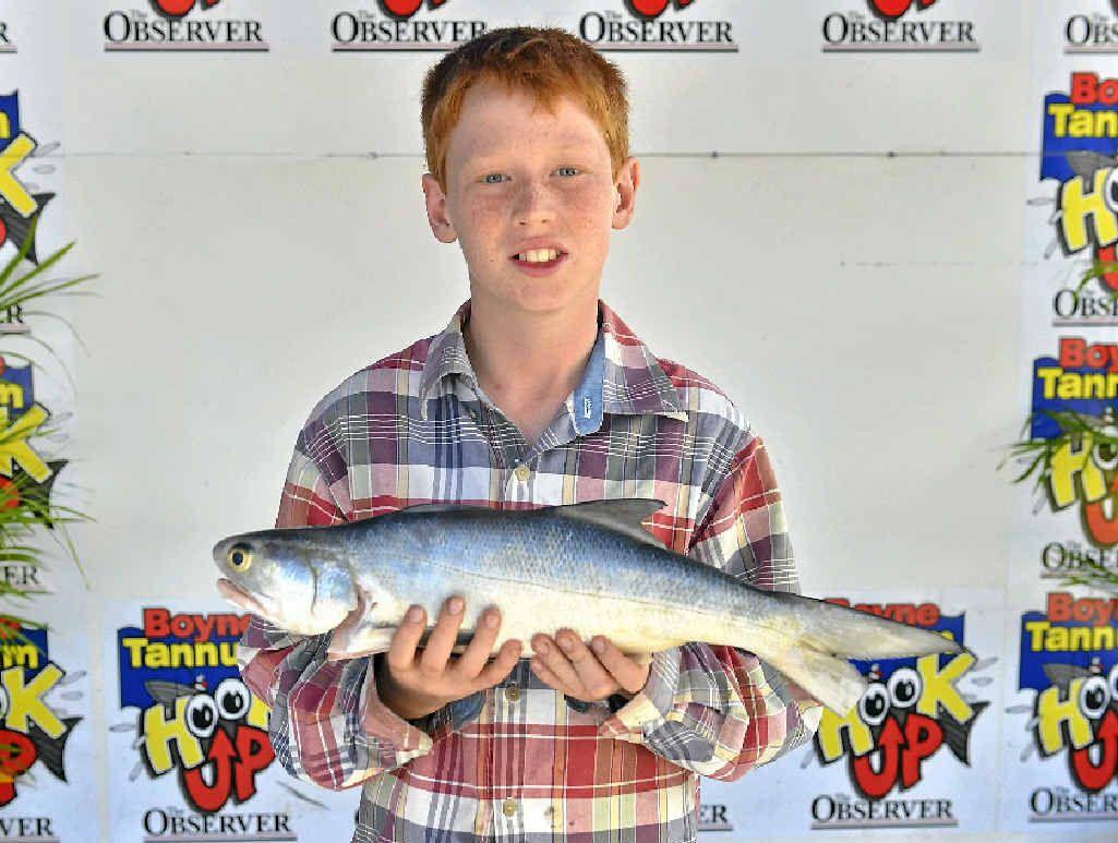 FAMILY FUN: Tomas Carige snags a beauty at last year's Boyne Tannum HookUp.