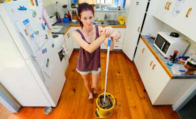 CLEANING LADIES: Gabby Dargel's hard at work mopping the kitchen and proving women do more housework than men.