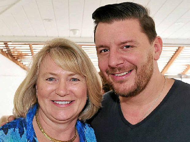 Chris Kerrison, of Brisbane, with Manu Feildel.