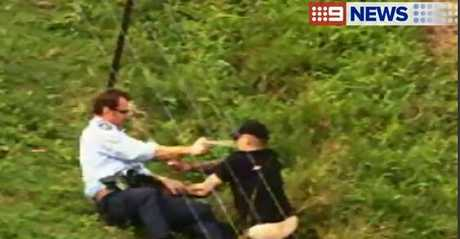 A police officer uses capsicum spray to subdue a man involved in a dramatic police chase in the Lockyer Valley.