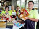 Warehouse manager David Slean with volunteers Margaret Erntner, Marj Smith and Joyce Lavery preparing for the Lifeline mega book and toy sale.