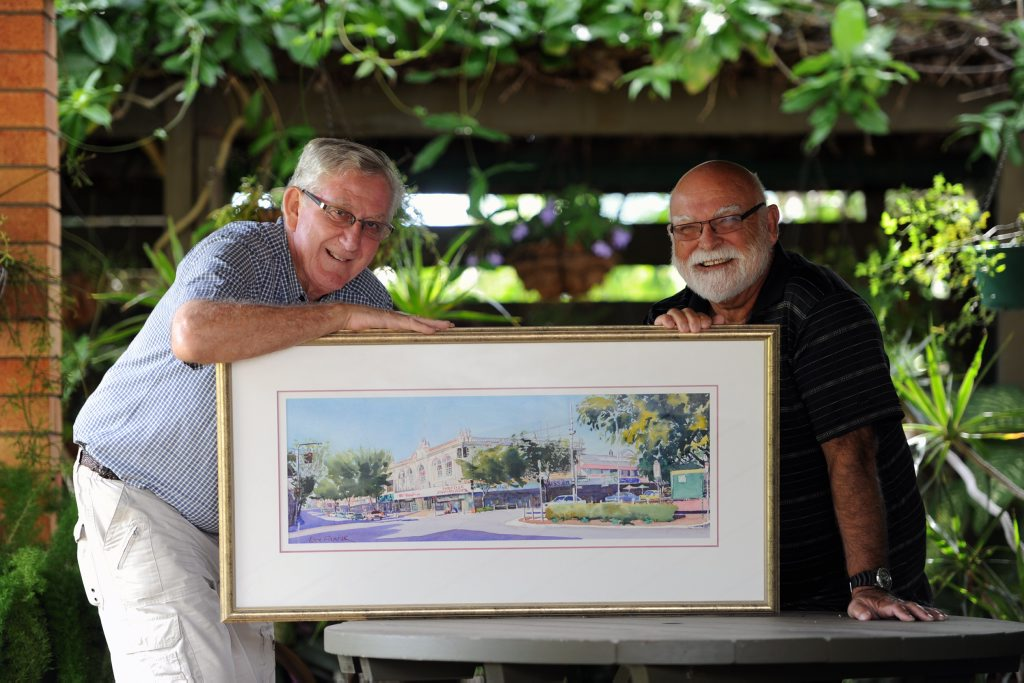 Artist Lex Frank and his painting titled Maryborough Streetscape poses with Heritage Awards committee chairman Roger Bowden.