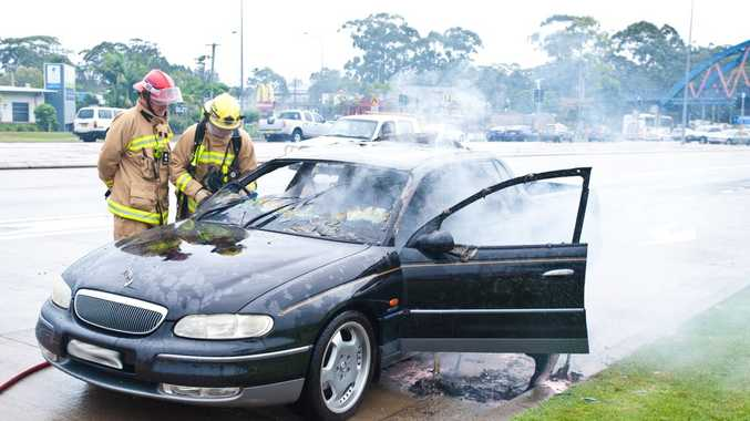 A dual cab Holden ute catches fire outside Park Beach HomeBase. Photo: Rob Wright / The Coffs Coast Advocate