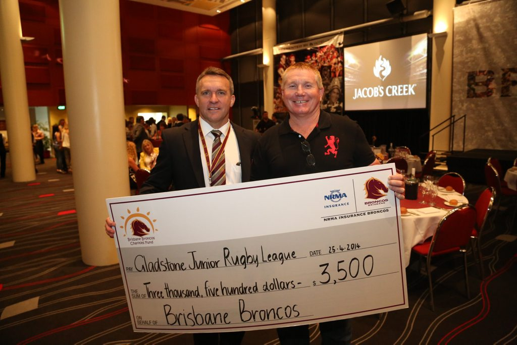 Broncos CEO Paul White and Gladstone District Junior Rugby League President Richard Duff celebrating the partnership which saw the local association donated $3,500.
