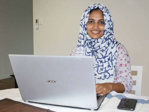 WELL STUDIED: Mother and former CQUniversity student Nusra Noorudheen going through her emails.