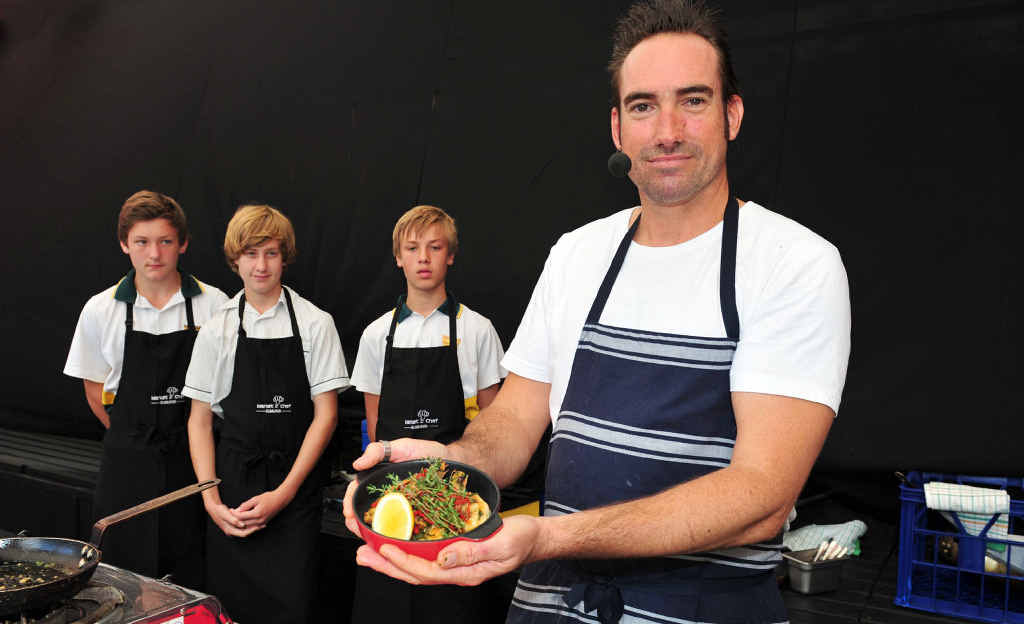 PLATING UP: Maroochydore High students Connor Ryan, Jaiden Richards and Dylan Benning with chef Bryce Davis.PHOTO: GEOFF POTTER
