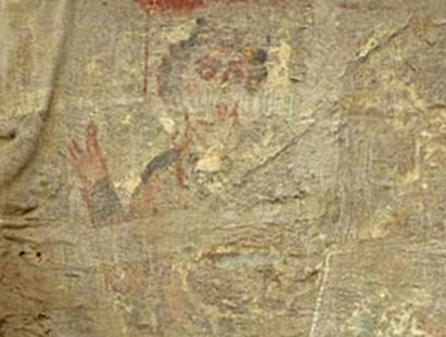 An image buried deep within crypt shows a young man with curly hair, who appears to be giving a blessing . Photo / University of Barcelona
