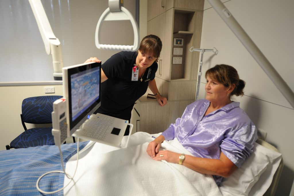 St Stephen's Hospital clinical nurse manager Larnie Wright with mock patient Jan Wieland in the prototype patient room.