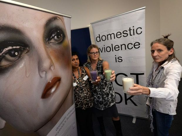 NOT OK: Family Relationship Centre's Denise Fines, Phoenix House's Petrina Elliott and Family Relationship Centre's Genevieve Houston support the domestic violence awareness month's candlelight remembrance vigil. Photo: Mike Knott / NewsMail