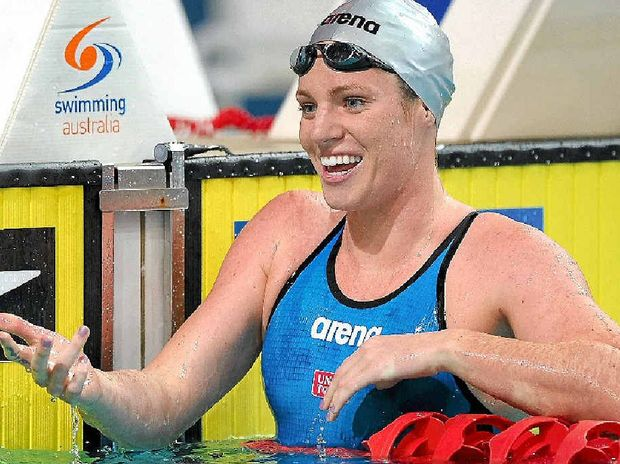 Emily Seebohm celebrates winning the final of the women's 50m backstroke at the 2014 Australian Swimming Championships at Brisbane Aquatic Centre last month.