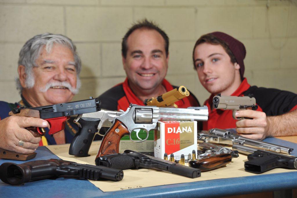 FIRM FANS: Sunshine Coast Shooting Club vice-president Russell Davis (left), club captain Paul Monaghan and Daniel Hazelton at the Yandina facility. Iain Curry