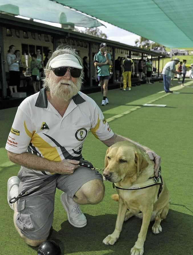 Dave Byars and Queeny take a break at the Calliope Central Bowls Club's Guide Dogs Queensland fundraiser on Saturday.