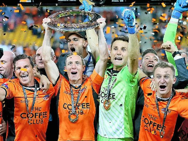 Brisbane Roar players celebrate after they defeated the Western Sydney Wanderers in extra time to win the 2014 A-League grand final.
