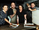 Dan and Steph Mulheron (centre) hard at work on the publication of their cookbook which will be on the shelves in October with food stylish Krista Graham and photographer Glen Wilson.