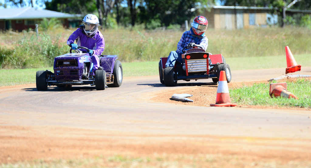 ROUND THE BEND: Ken Booy and Russell Smith battle it out around the bend in heat one of the A-grade at the Queensland Ride-On Mower Championships at Yaamba.