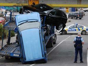Audi ouch! Car transporter slams into bridge