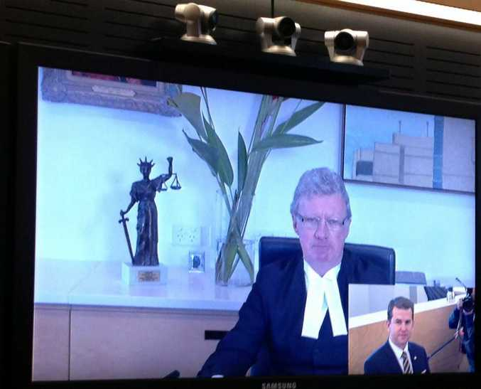 Chief Justice Paul De Jersey and Attorney General Jarrod Bleijie demonstrate the video links.