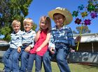 Twins Roland and Jaylan Roberts with Charlie Sommers and Glenrowan Roberts find a spot in the sun to watch the horse events at the Taroom Show.