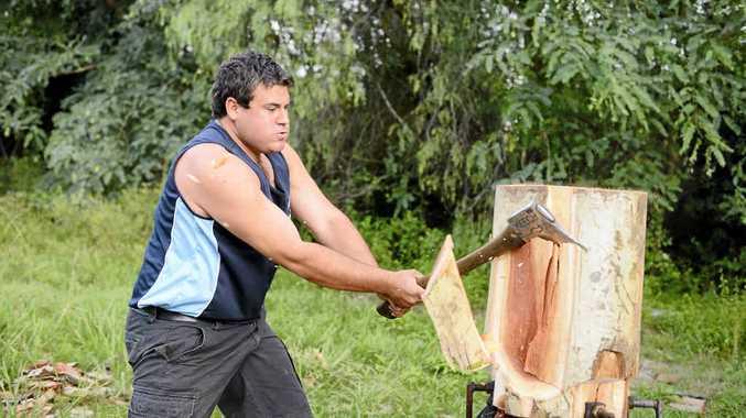 TAKE THAT: Woodchopping steward at Grafton Show Chris Owen in action. Photo Adam Hourigan