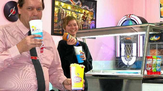 Owner Jeff Clark tries out a smoothie with Kahlia Stevenson.
