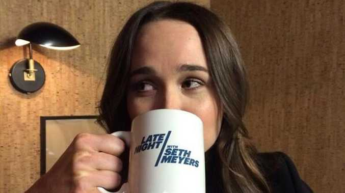 Ellen Page sipping from her Late Night with Seth Meyers mug