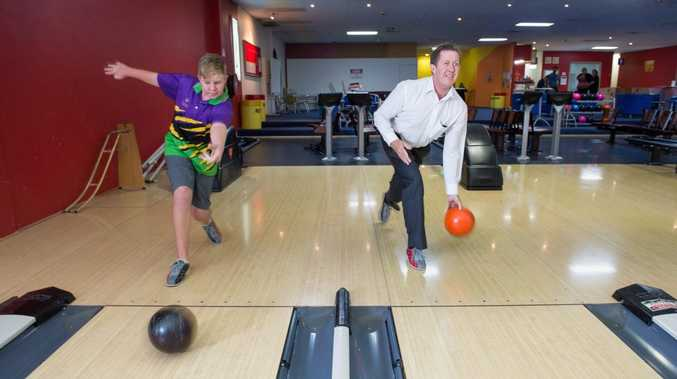 CONTEST: Bowler Cameron Pollard gets the jump on Cowper MP Luke Hartsuyker in their Ten Pin Bowling duel. Photo: Trevor Veale / Coffs Coast Advocate