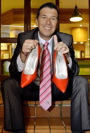 Ipswich Cr Andrew Antoniolli with his red shoes after taking part.