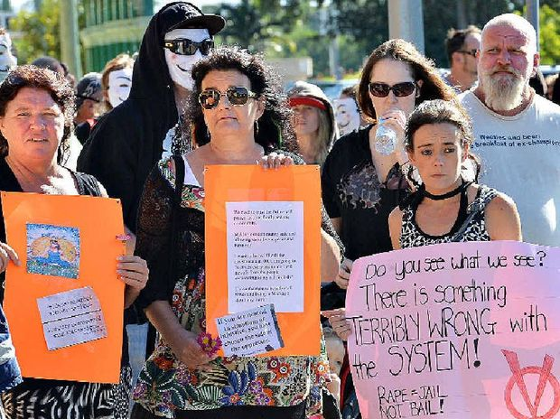 More than 60 people gather outside the Mackay Courthouse with members of Anonymous Mackay, in a protest against two police receiving bail over the alleged rape of a woman.