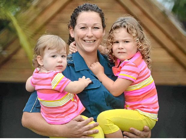 BALANCING ACT: Paramedic Gayle Slaughter is looking forward to spending Mother's Day with her daughters Lily, 1, and Mia, 3.