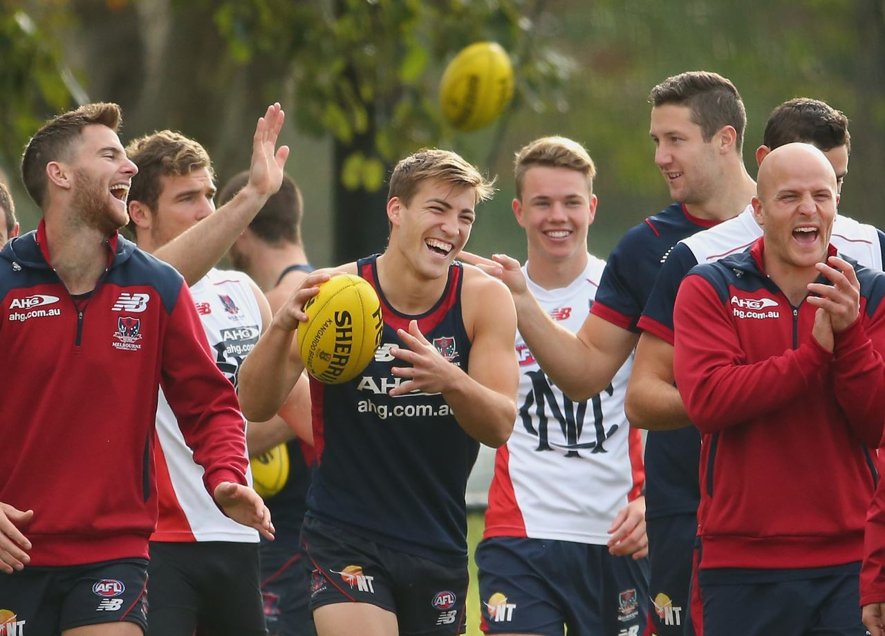 MELBOURNE, AUSTRALIA - MAY 09: Jack Viney (C), James Frawley and Nathan Jones of the Demons laugh during a Melbourne Demons AFL training session at AAMI Park on May 9, 2014 in Melbourne, Australia.