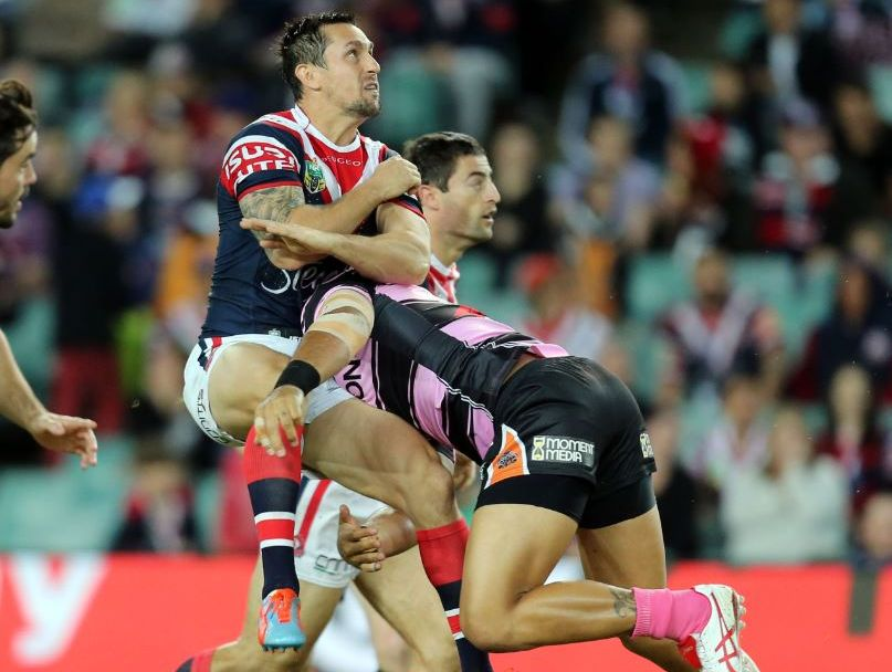 Rooster's Mitchell Pearce hit in the air by Tiger's Adam Blair during the round 9 NRL match between the Sydney Roosters and the Wests Tigers at Allianz Stadium in Sydney, Friday, May 9, 2014.