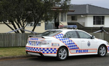 Police outside Christine Malone's home on the morning she was found dead.