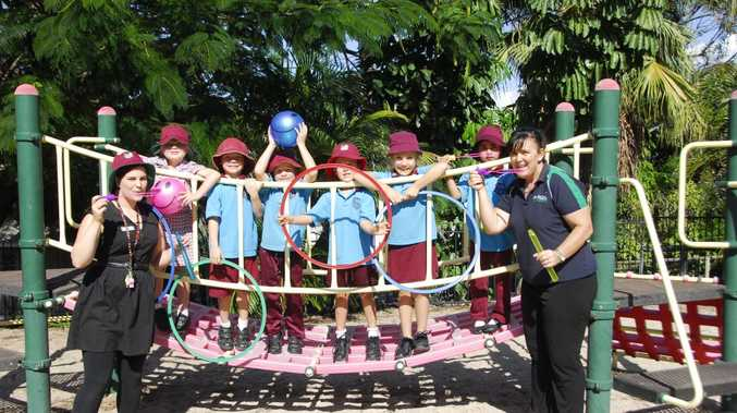 Students from Gladstone Central State School and prep teacher Kirsty Harris (left) and GAPDL Communities for Children project officer Debbie Flaherty (right) are excited for this year's Under 8's Day activities.