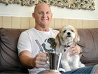 SOUND ADVICE: Former rugby league player Kerrod Walters at home with his dog, Bella, is promoting health checks following his open heart surgery.