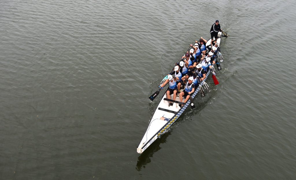 The Mt Warning Dragon Boat team in the Tweed River, going under the Condong bridge.