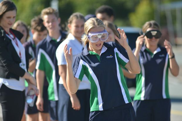 Students at Unity Collge taking part in a research study on educating students about the effects of alcohol. Alyssa Ralph tries walking with beer goggles. Photo: Warren Lynam / Sunshine Coast Daily